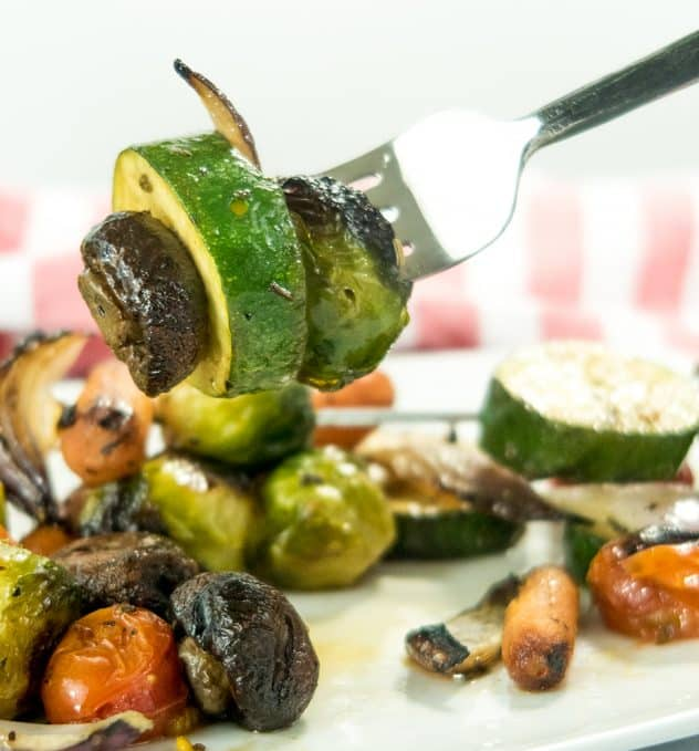 grilled mushroom, zucchini and brussel sprout on a fork