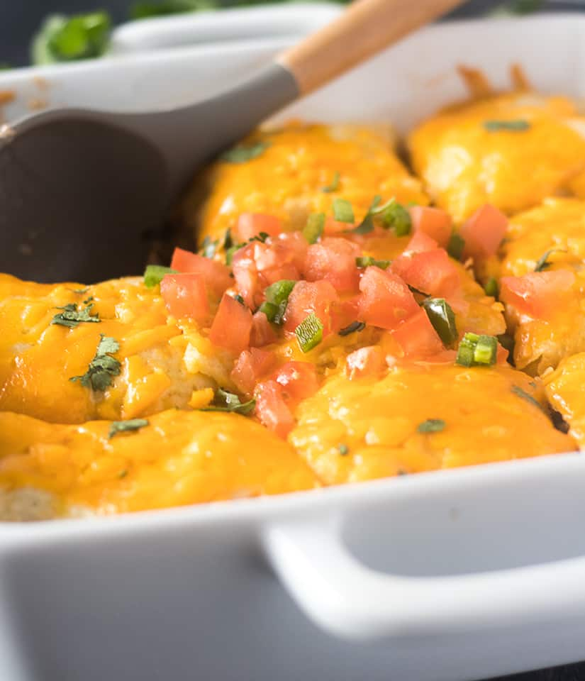 Taco Casserole topped with cheese, chopped tomatoes, jalapeno, and cilantro.