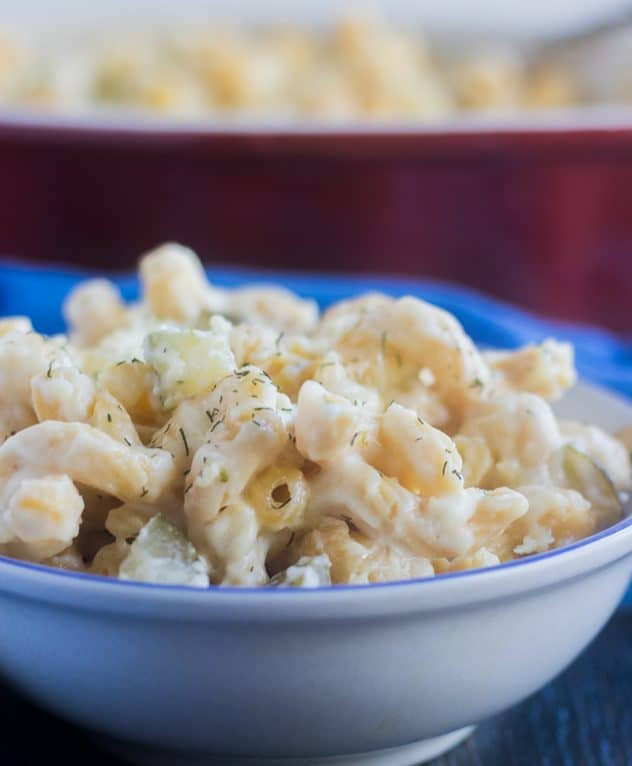 Baked Mac and Cheese with dill pickles in a white bowl