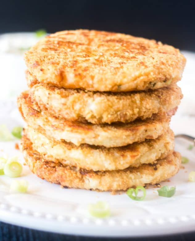 Mashed potato cakes stacked on a plate