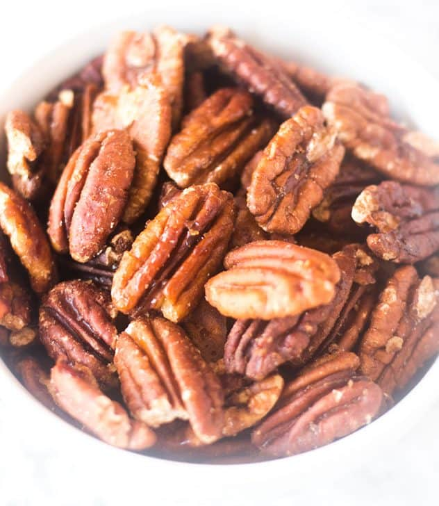 Maple Cinnamon Roasted Pecans in a white bowl.