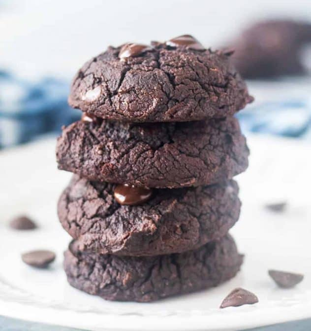 Black Bean Cookies on a white plate with chocolate chips on the plate.