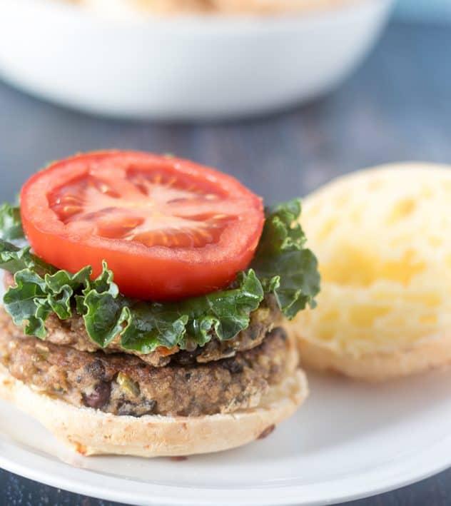 Veggie Burger topped with lettuce, tomato on a gluten free burger bun