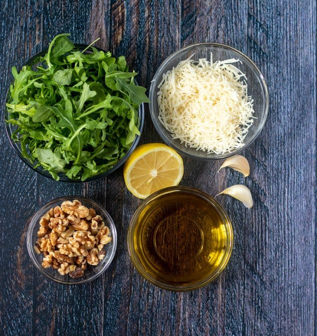 Arugula, parmesan cheese, walnuts, lemon, garlic cloves, olive oil.