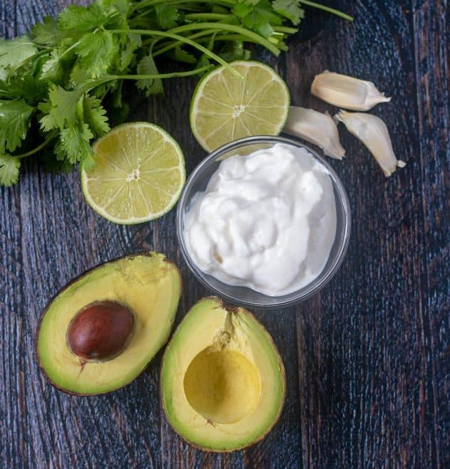 Avocado, greek yogurt, lime, garlic cloves, and cilantro