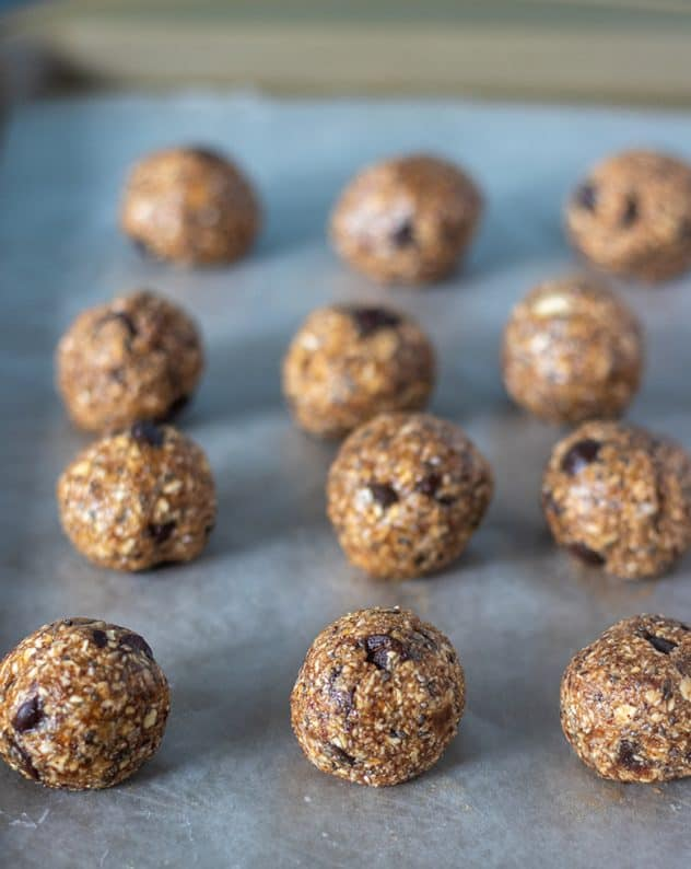 Chocolate Almond Butter Energy Bites on baking pan lined with wax paper.