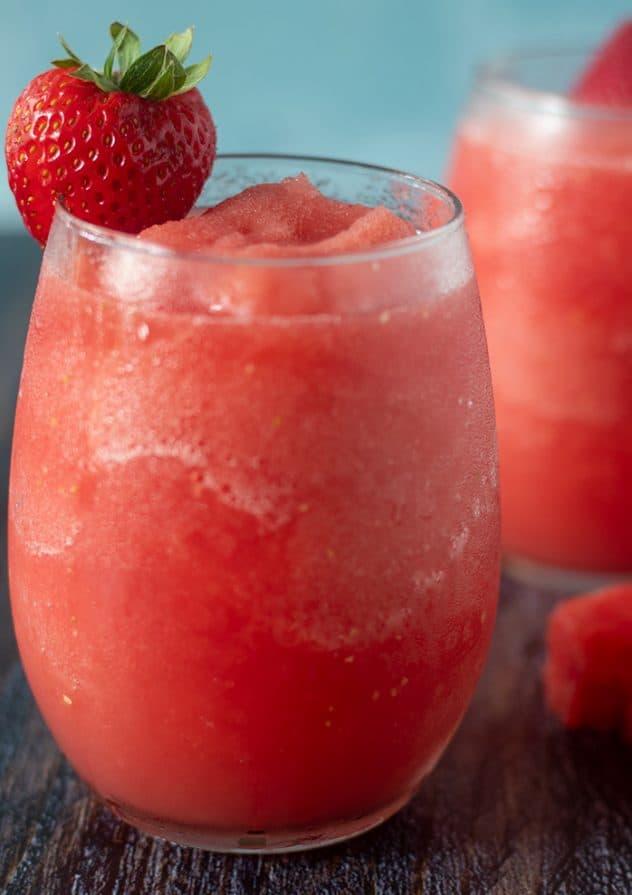 Watermelon Strawberry Wine Slushies in a glass garnished with a strawberry.