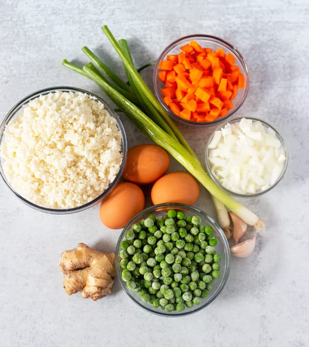 Cauliflower rice, diced carrots, diced onion, peas, garlic cloves, eggs, scallions, ginger root