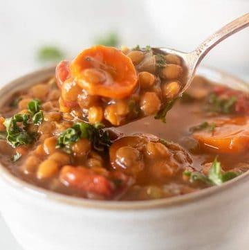 slow cooker lentil soup on a spoon