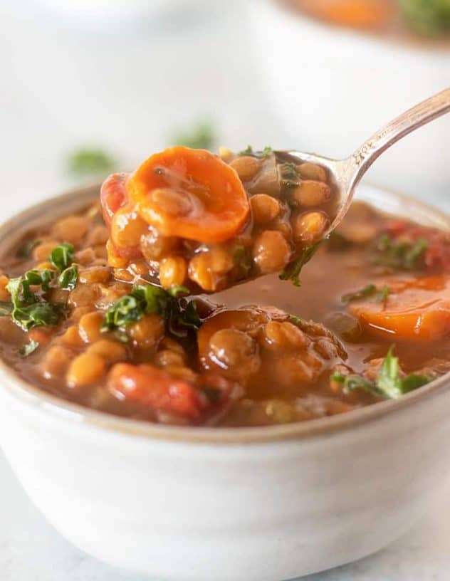 slow cooker lentil soup on a spoon