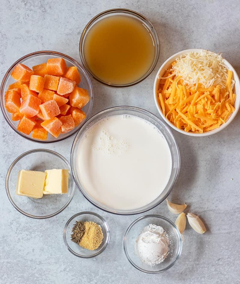 butternut squash, vegetable broth, cheese, butter, half & half cream, cornstarch, garlic, seasonings.
