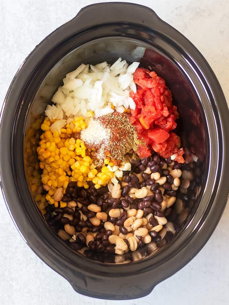 slow cooker taco soup ingredients in the crockpot