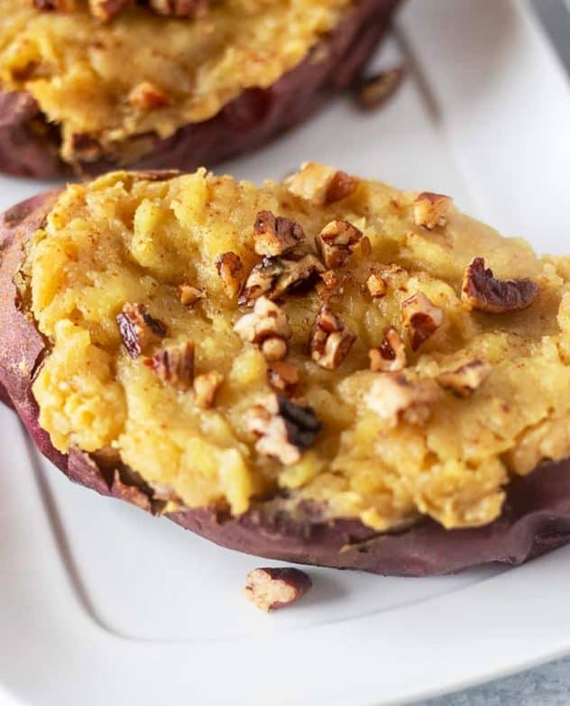 Twice baked sweet potatoes topped with toasted pecans.