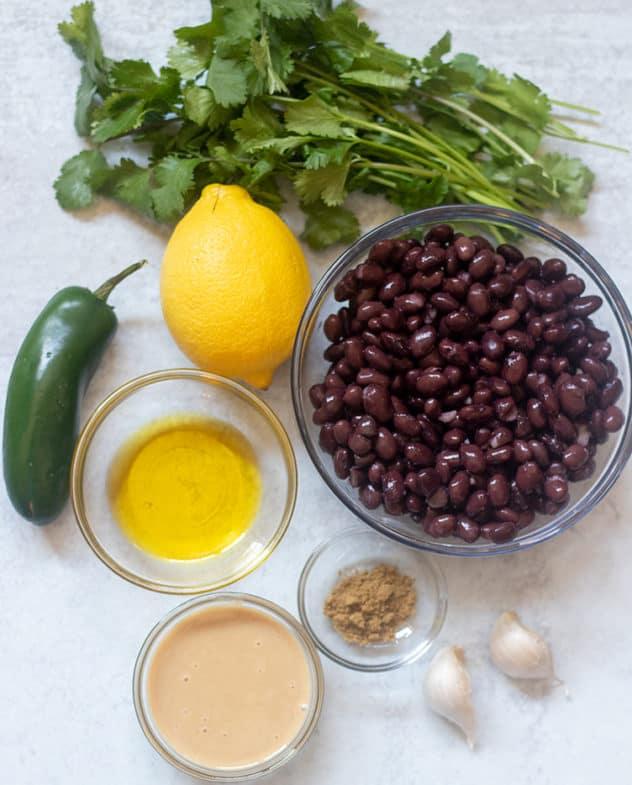 black beans, lemon juice, jalapeno, tahini, garlic cloves, cumin olive oil