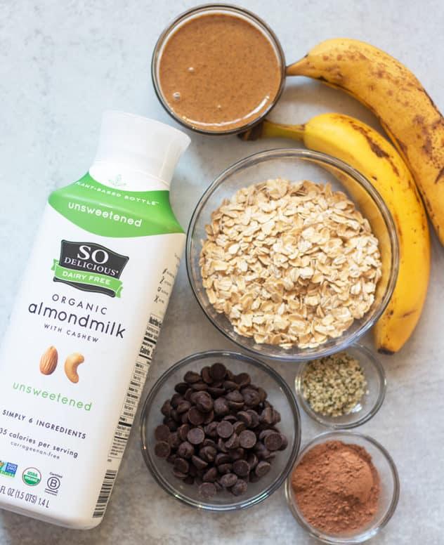 almond milk, dark chocolate chips, cocoa powder, rolled oats, hemp seeds, bananas