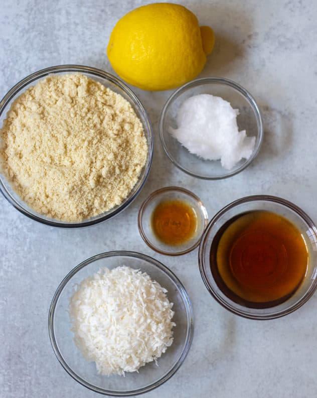 almond flour, lemon, coconut oil, vanilla extract, maple syrup, coconut flakes