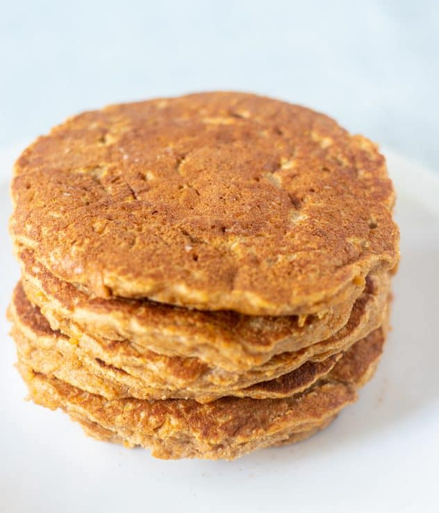 Sweet potato pancakes stacked on a plate