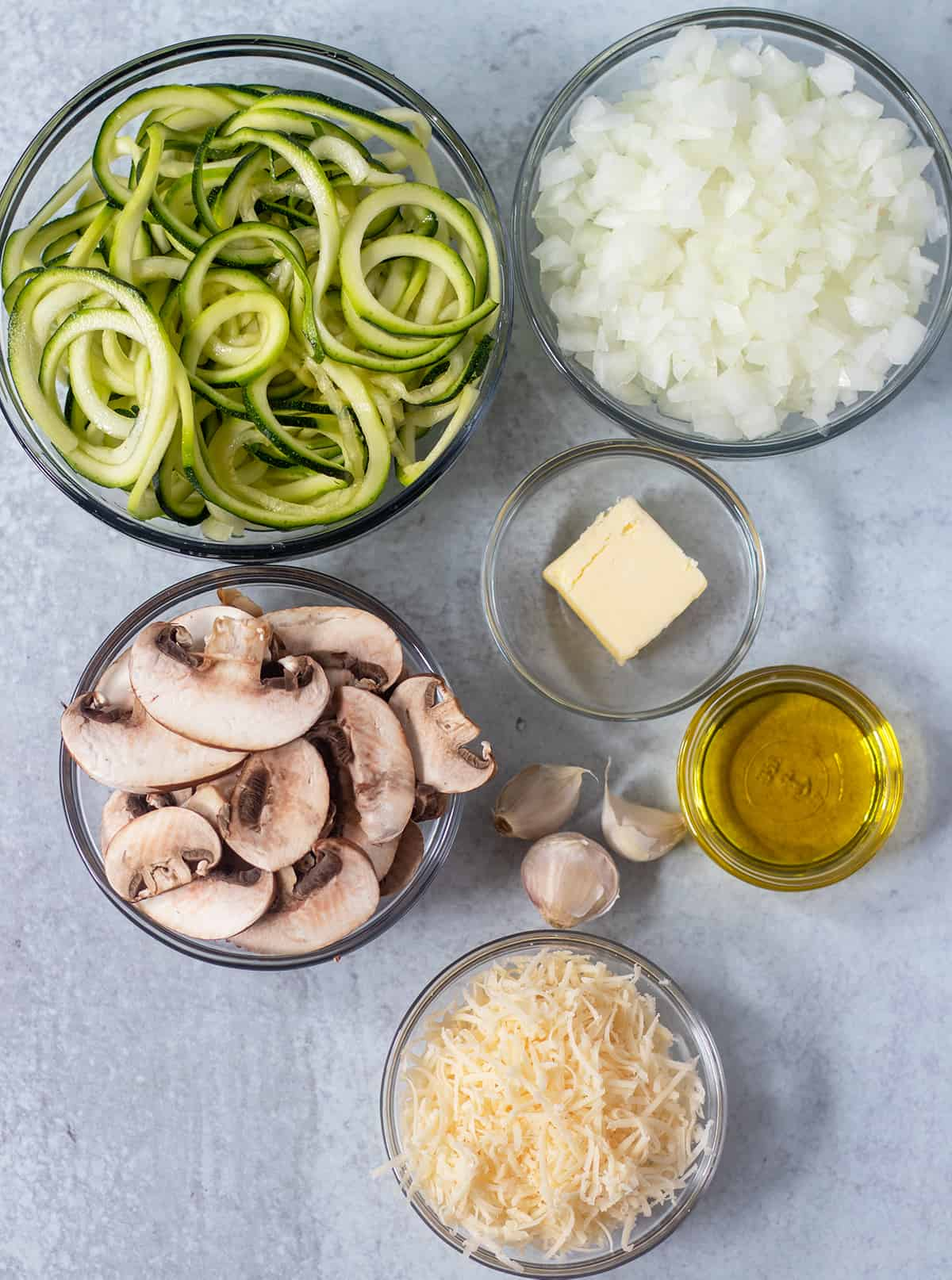 zucchini noodles, onions, mushrooms, garlic, butter, olive oil, parmesan cheese