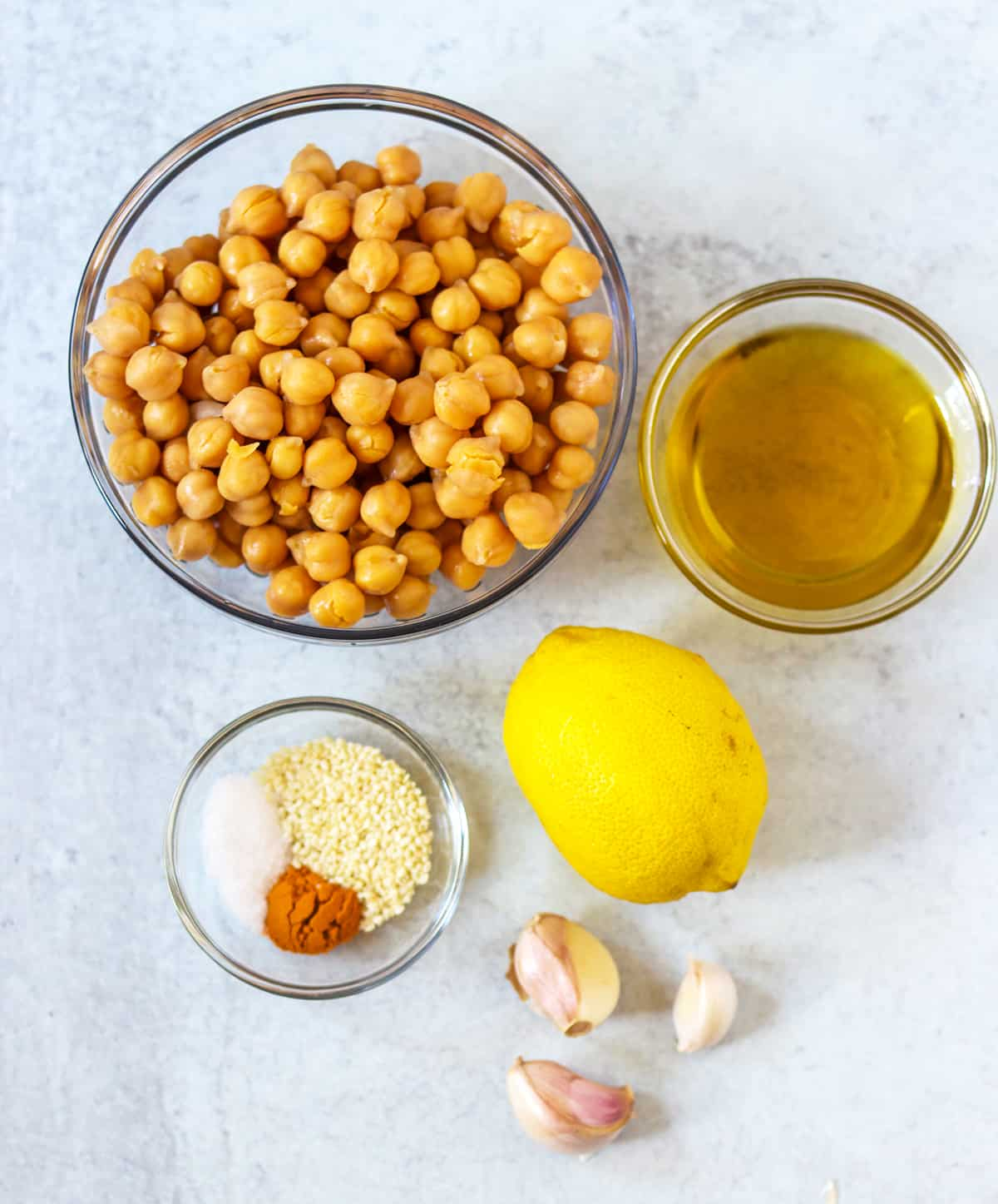 ingredients in this turmeric hummus. chickpeas, olive oil, lemon, sesame seeds, turmeric, salt, garlic cloves