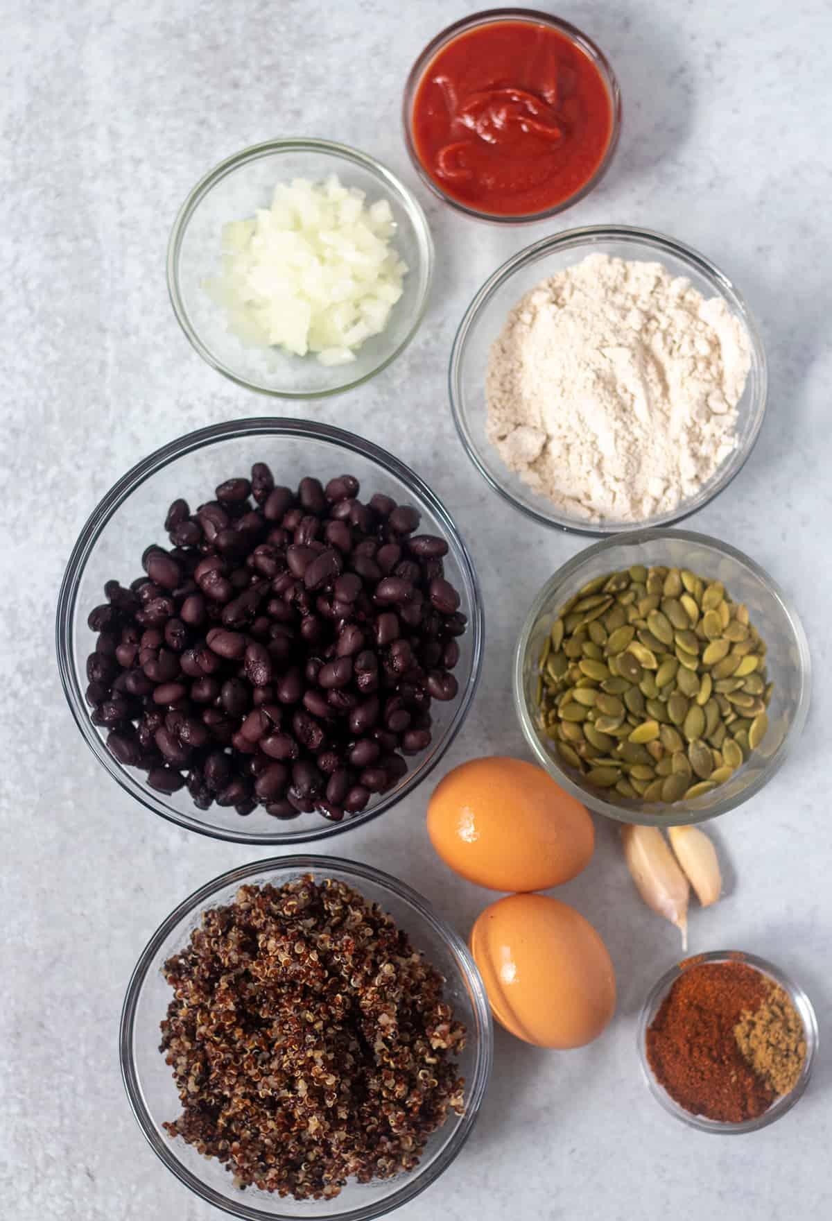 black beans, onion, ketchup, oat flour, quinoa, pumpkin seeds, eggs, garlic cloves and seasonings