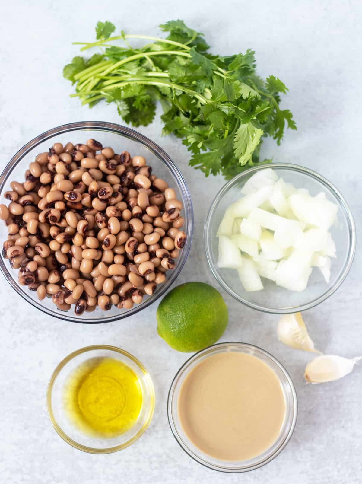 black-eyed peas, onion, garlic, cilantro, lime, olive oil, tahini