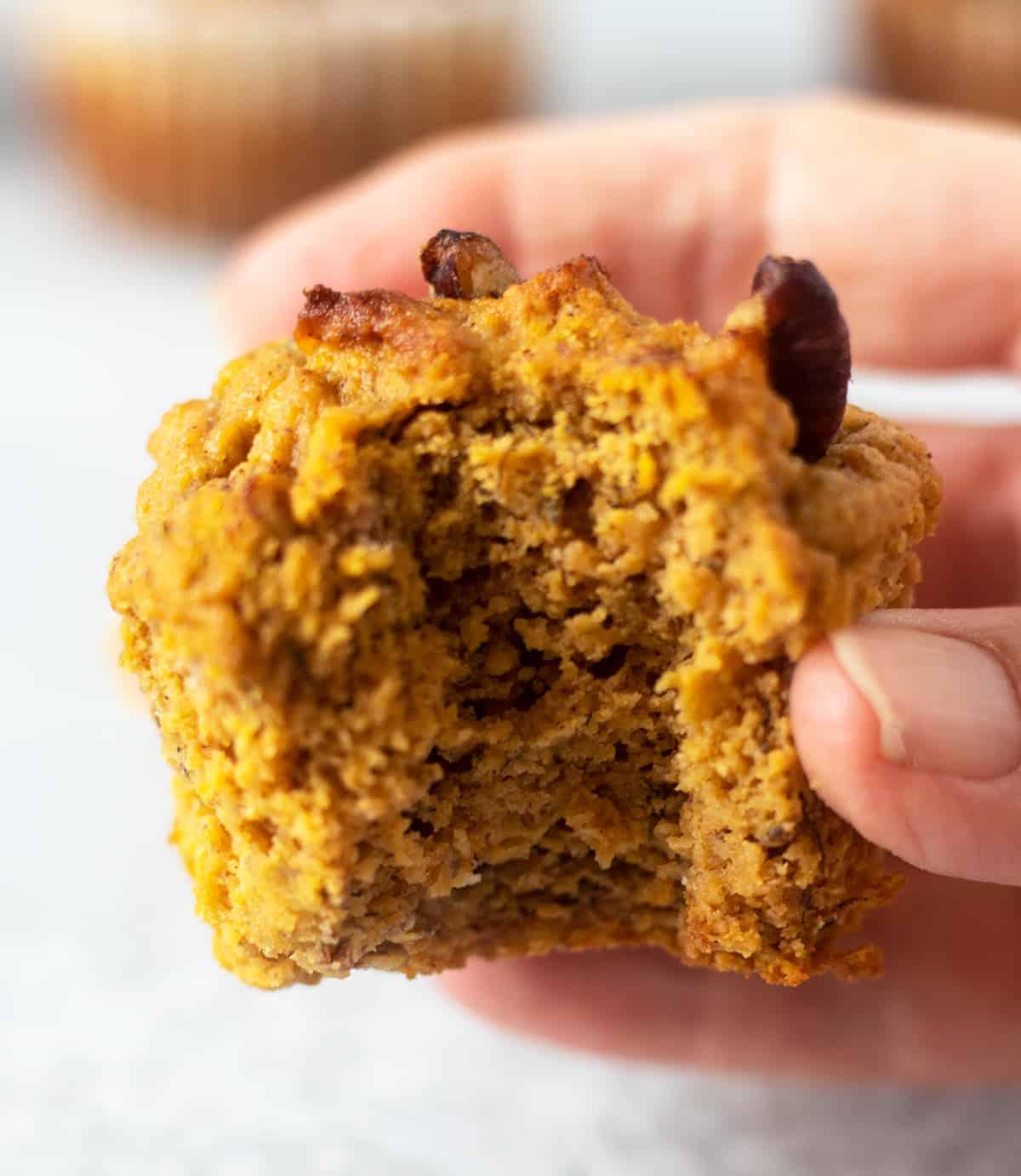 pumpkin muffin that has been biten.