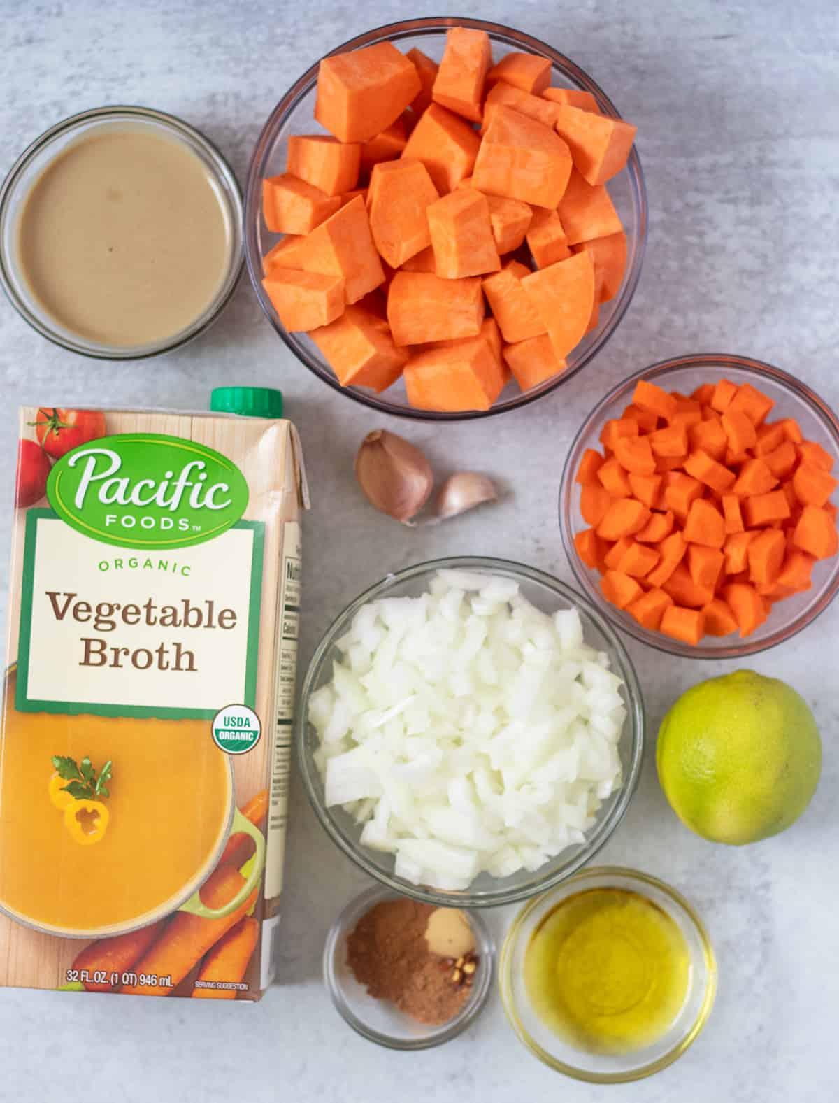 sweet potatoes, tahini, vegetable broth, garlic, carrots, onion, lime, olive oil, seasonings