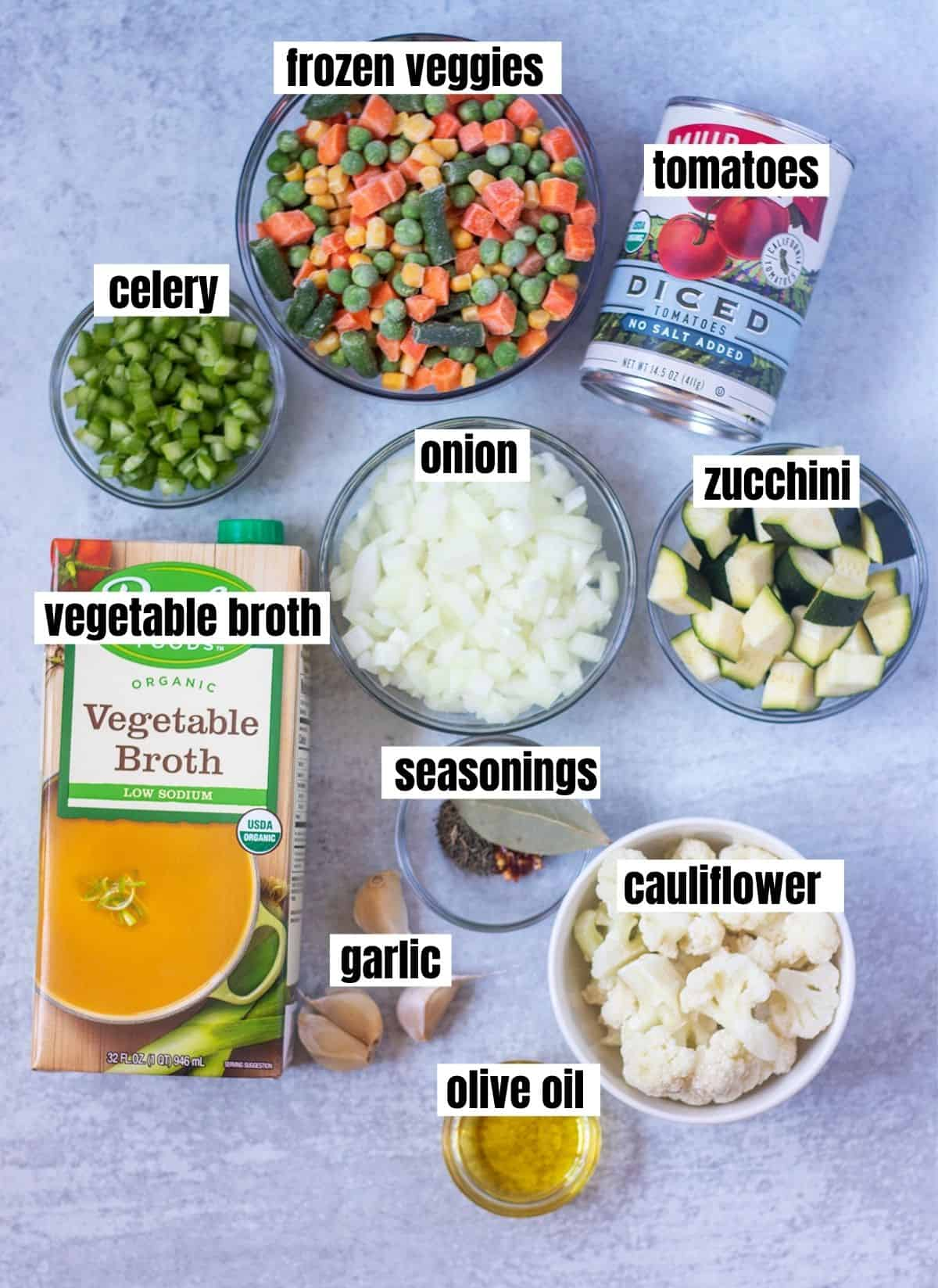 frozen vegetables, canned diced tomatoes, chopped celery, chopped onion, chopped zucchini, vegetable broth, seasonings, cauliflower florets, garlic and olive oil