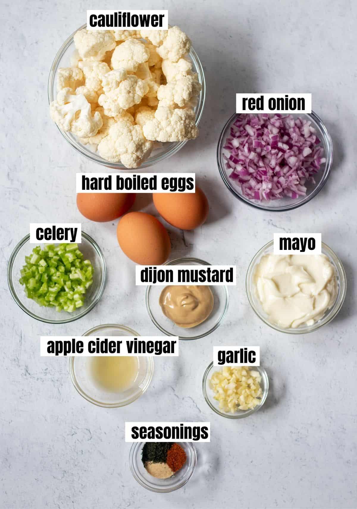 cauliflower, red onion, hard boiled eggs, celery, dijon mustard, mayo, apple cider vinegar, garlic and seasonings.