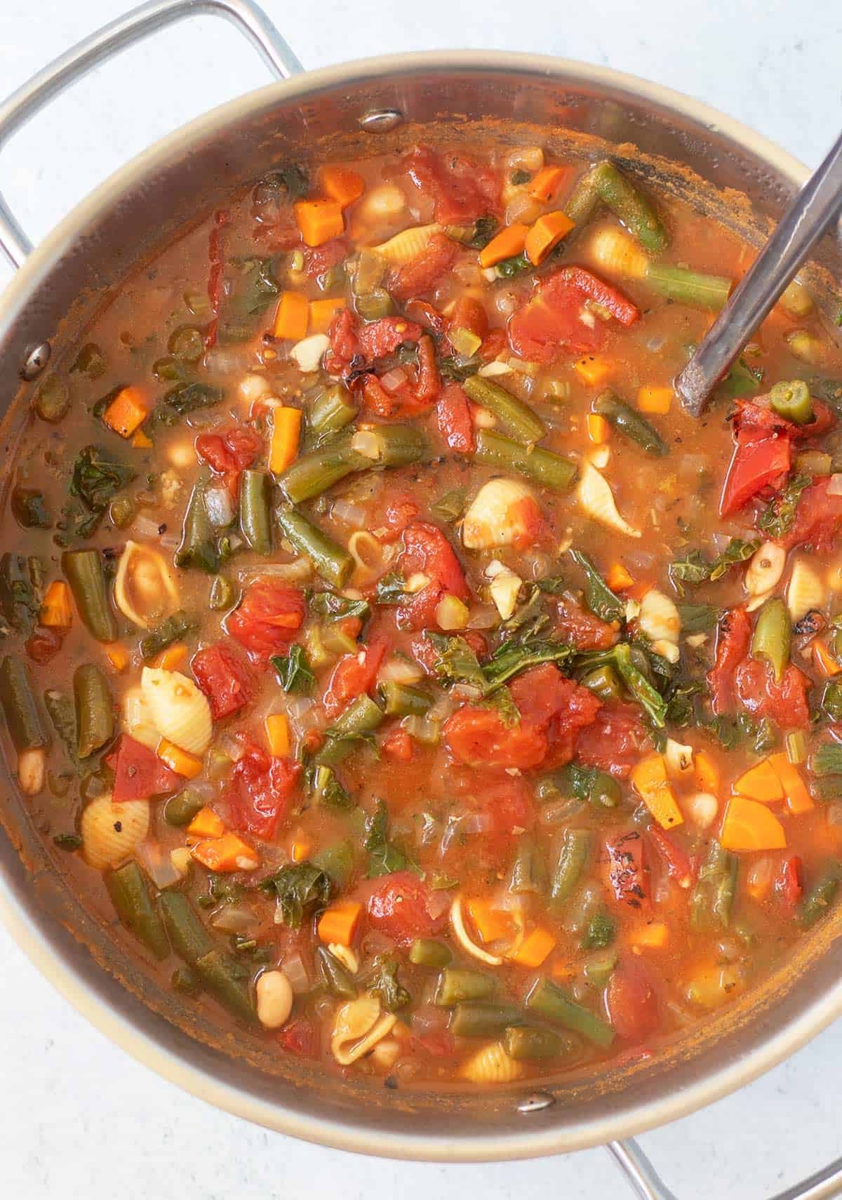 vegetarian minestrone soup in large stainless steel soup pot.
